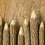 wooden pencils on wood background